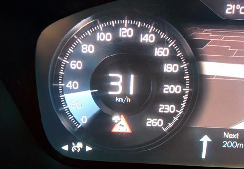 A warning appears on the dashboard of a Volvo car during a demonstration at Mobile World Congress in Barcelona on March 3, 2015