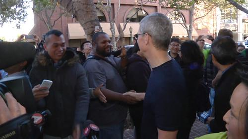 Tim Cook shakes hands with customers outside the Apple Store in Palo Alto on September 19, 2014.