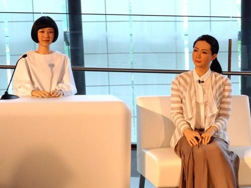 "Robots Kodomoroid (left) and Otonaroid were shown off Tuesday in Tokyo, where the androids got ""jobs"" at a technology museum."