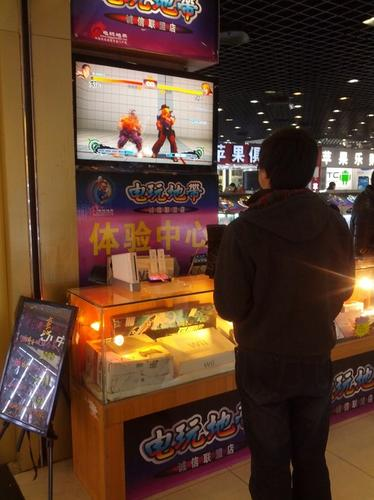 A customer playing Street Fighter in China.