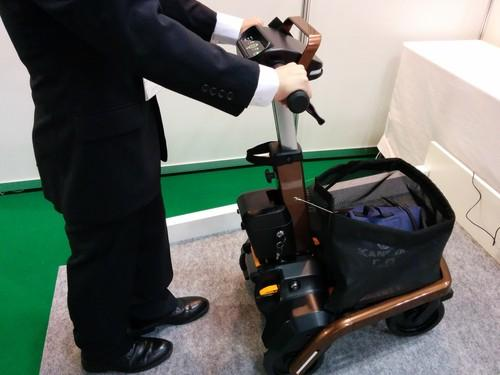 RT Works, a Japanese startup, shows off a connected robotic walker for elderly users at Japan Robot Week in Tokyo on Thursday.