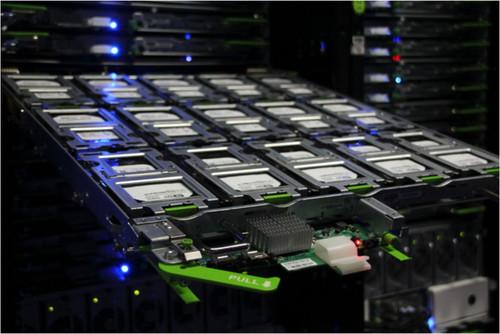 A shelf of hard drives in a Facebook cold storage system