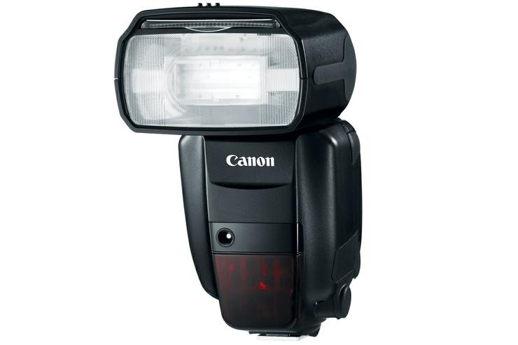 Use a camera flash like this Canon Speedlite 600EX-RT to light up your photos.