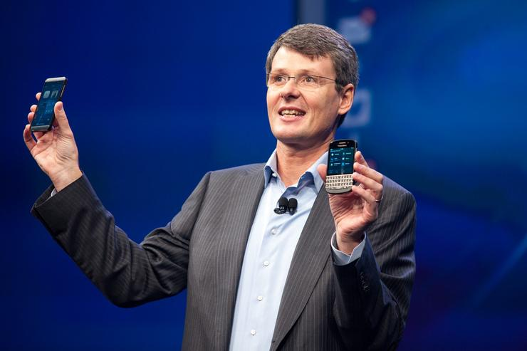 BlackBerry CEO Thorsten Heins presenting the new BlackBerry Z10 (left) and the Q10.