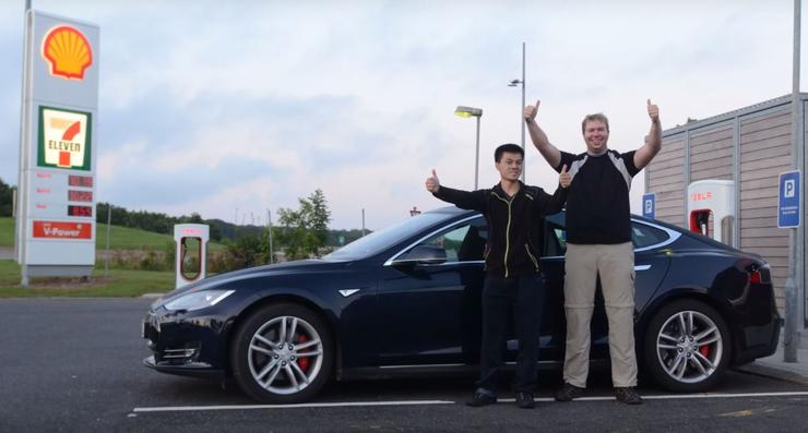 Programmer Bjorn Nyland and his co-driver standing in front of the Model S P85D