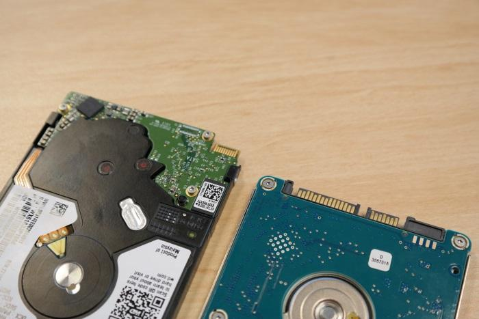 The WD drive on the left requires an adapter cable, while the Seagate on the right has a standard SATA interface built in.