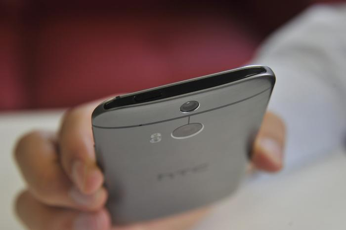 The plastic strip, which houses the power button, is one way HTC has improved the M8's IR, Wi-Fi and cellular signals