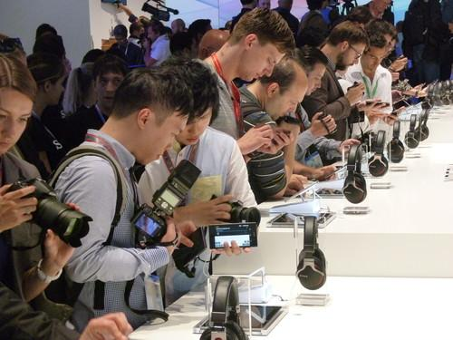Reporters look at Sony's new Xperia Z1 smartphone, on show at a Berlin news conference on September 4, 2013.
