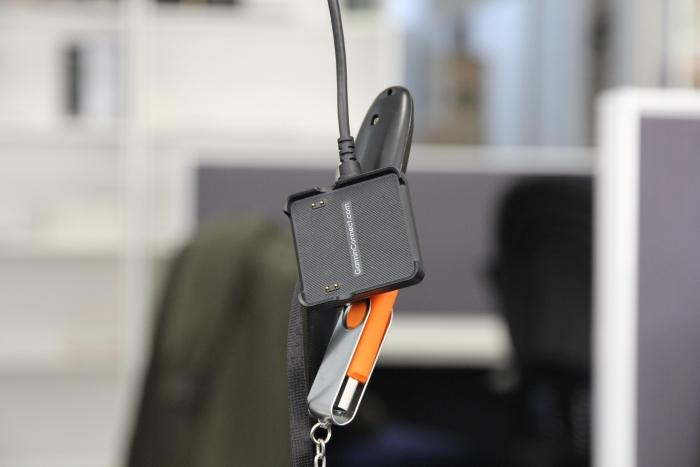 A magnet is used to hold the smartwatch to its charger. It's strong enough to attract nearby metal objects.