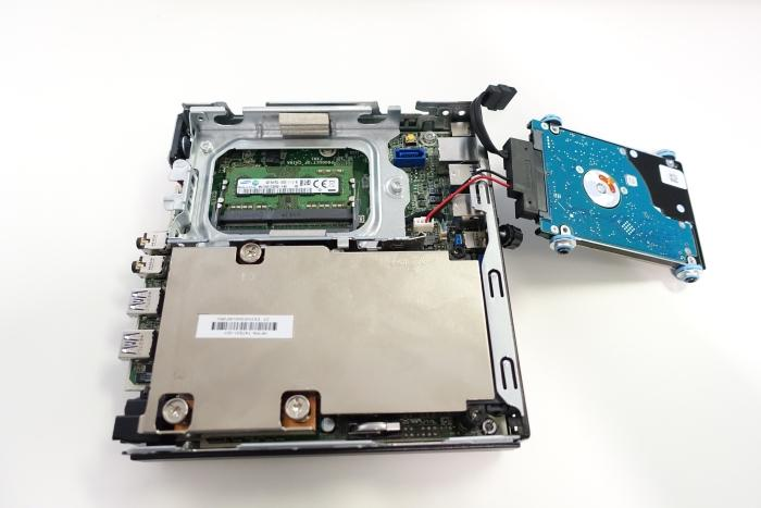 Remove the hard drive to access the memory slots.