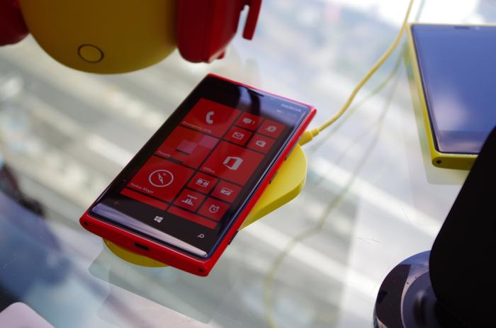 The Nokia Lumia 920, shown with optional wireless charging accessory.